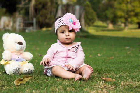 Baby on grass.