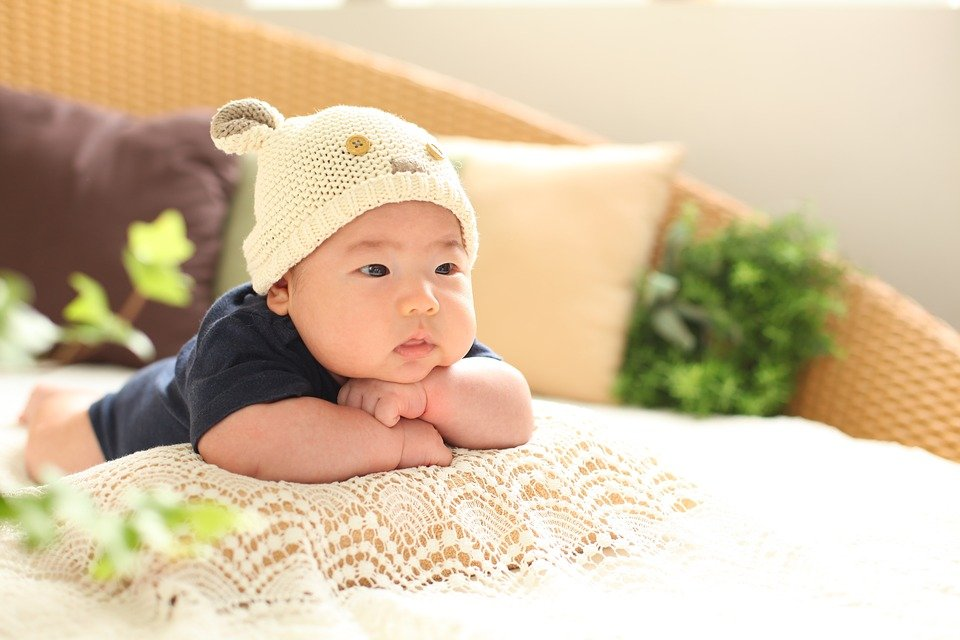 Baby upright with pillow.