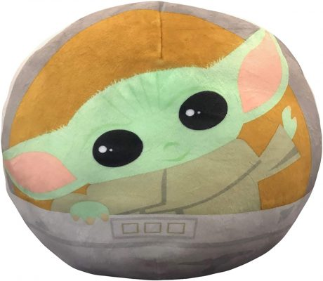 Face of Yoda from Star Wars on a baby pillow.